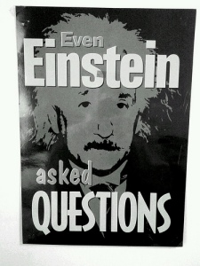 Poster of Albert Einstein with the following text:  Even Einstein asked Questions
