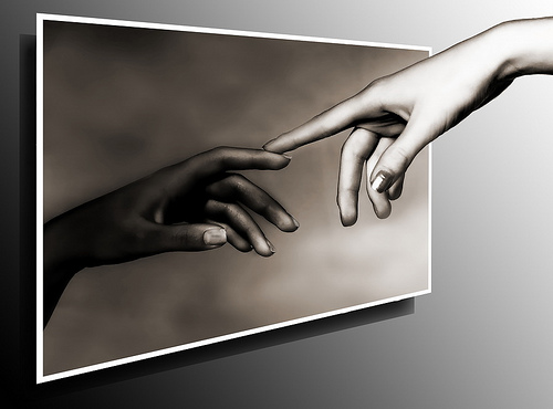 Hands with index fingers touching
