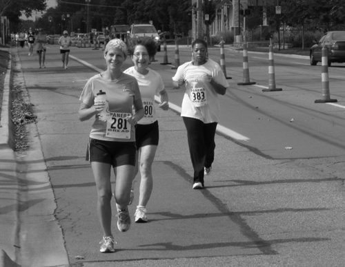Women Running and Smiling